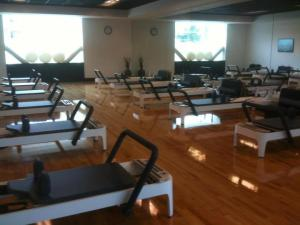 "In March 2012, Nike became the first fitness facility to feature large-scale group classes using the Allegro 2 reformer -- the newest verion of Joseph Pilates ""Universal Reformer."""